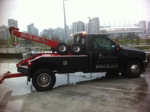 tow truck getting ready for a job on rooftop parking