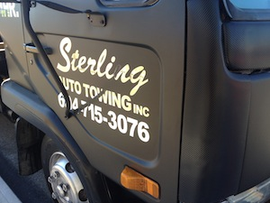 all our tow trucks are matte black wrapped in vinyl and carbon fibre